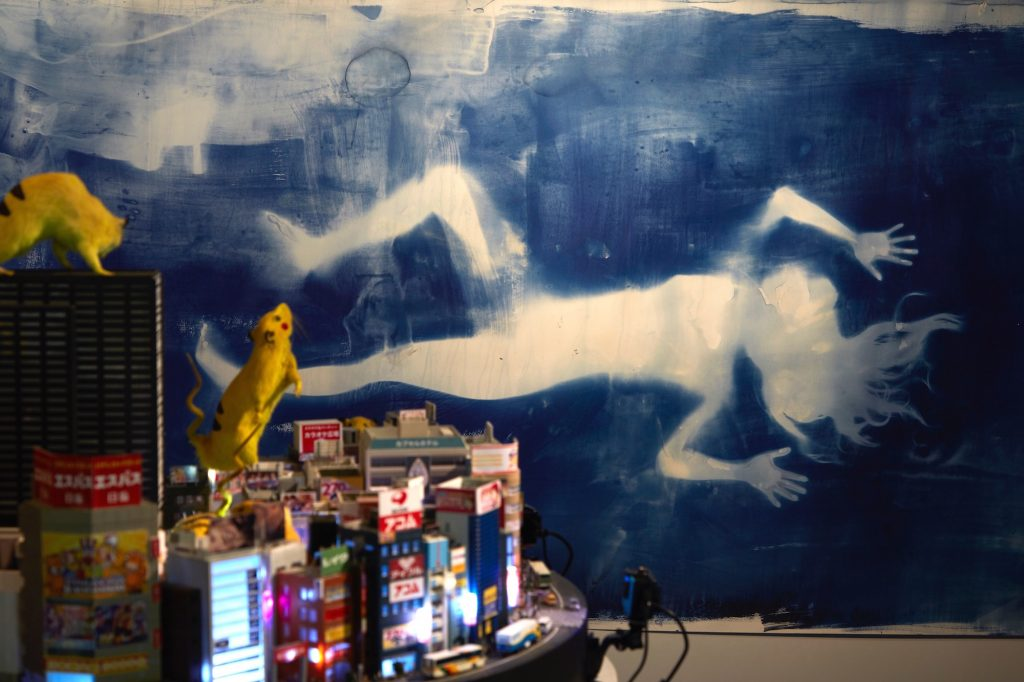 Drawing Mirai, 2016, The silhouette of Kabukicho's sex worker Mirai (age 18) is printed on the wall using blueprinting. Sex industry, sexual minorities, violence, culture, entertainment and aliens... Kabukicho continued to allow various ways of living. Chim↑Pom depicted the figure of Mirai, with a self claimed name which also means future, in this place where many lives intersect.